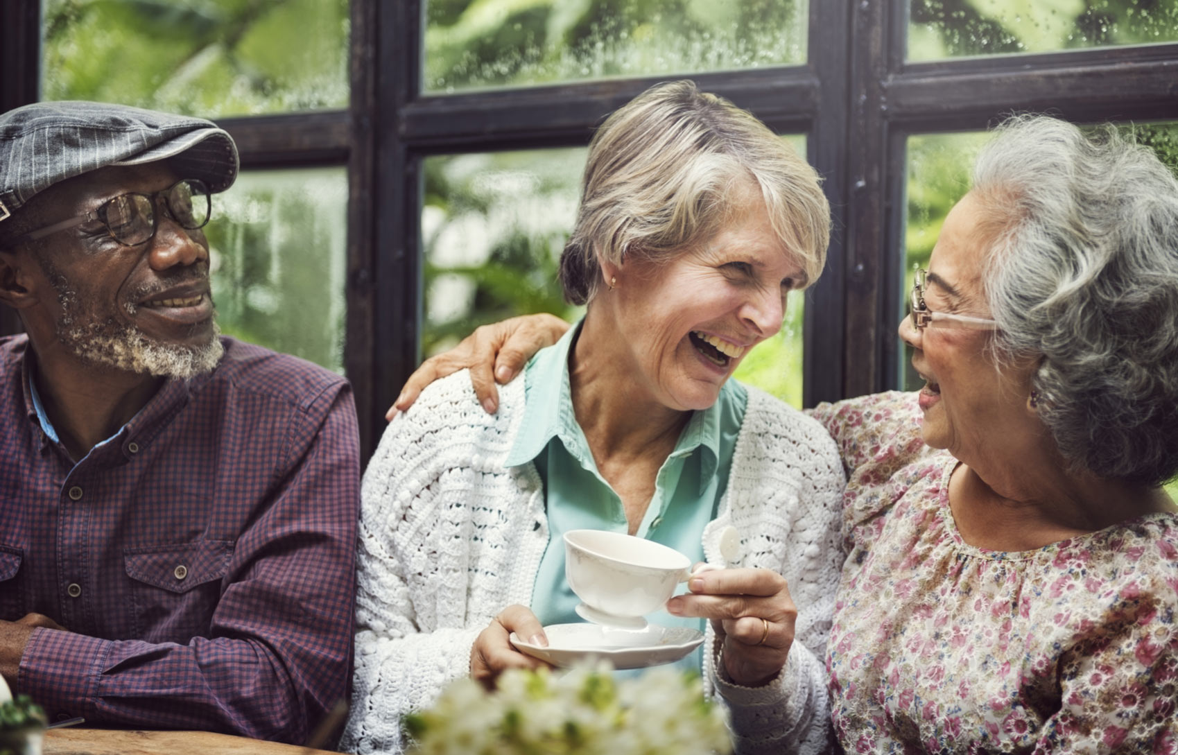 Diverse group of elderly people laughing